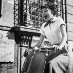 1953, Hollywood, Los Angeles, California, USA --- Audrey Hepburn gleefully drives a motorscooter on the set of Roman Holiday. --- Image by © Bettmann/CORBIS