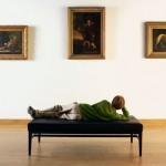 Boy Looking at Paintings in Art Gallery --- Image by © Randy Faris/Corbis