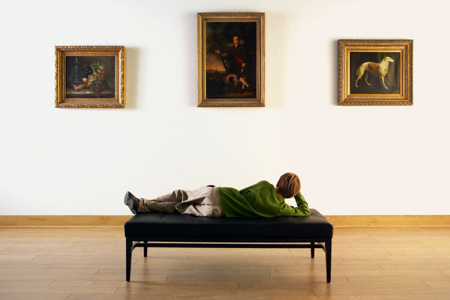 Boy Looking at Paintings in Art Gallery --- Image by © Randy Faris/Corbis