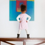 Little Girl Looking at Art --- Image by © Tim Pannell/Corbis